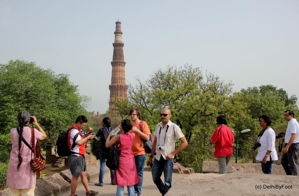 Standing against backdrop of Qutub Minar inside Mehrauli Archeaological Park