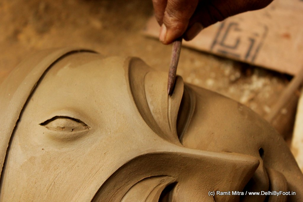 Sheer experience of many years of idol making gives the senior-most Kumhar, usually the Head Kumhar, the privilege the Head Kumhar creates the faces of the idols. of