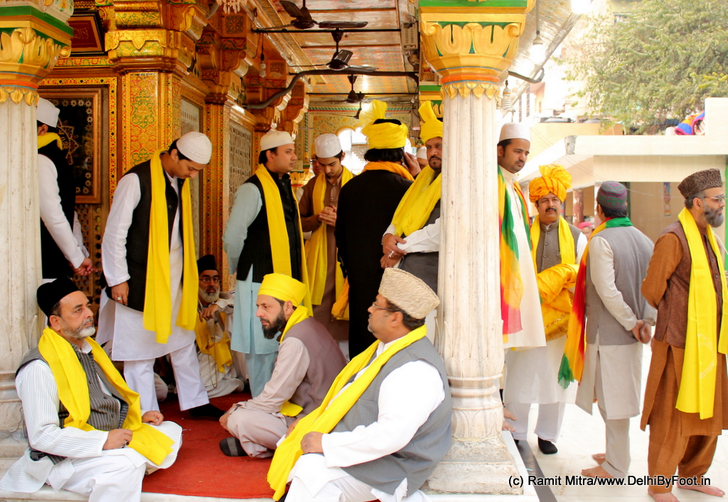 Officials and visitors to the Dargah in yellow