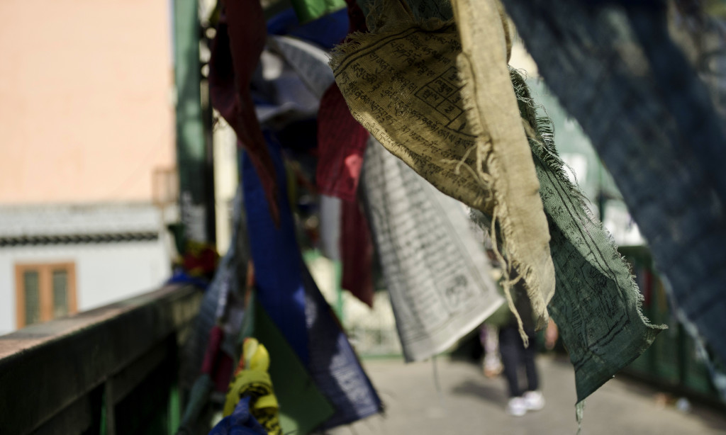 Prayer flags flutter in the morning wind